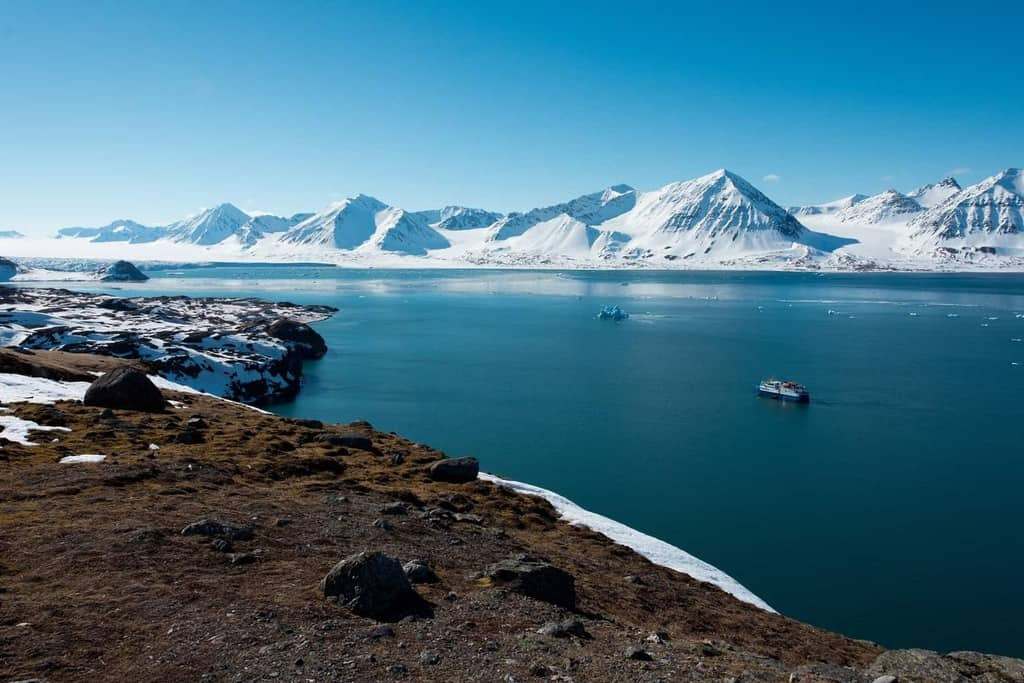 In this guide to visiting Svalbard, Norway, learn how to get to Svalbard and the methods of traveling around both on land and on an Expeditionary Ship. Also, learn about the best time of year to visit Svalbard, what to pack, where to eat and ideal hotels to stay on this Norwegian glaciated archipelago in the Arctic Ocean between mainland Norway and the North Pole.