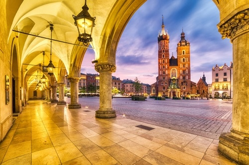 St. Mary's Basilica in the Main Square of Krakow, Poland at dusk.